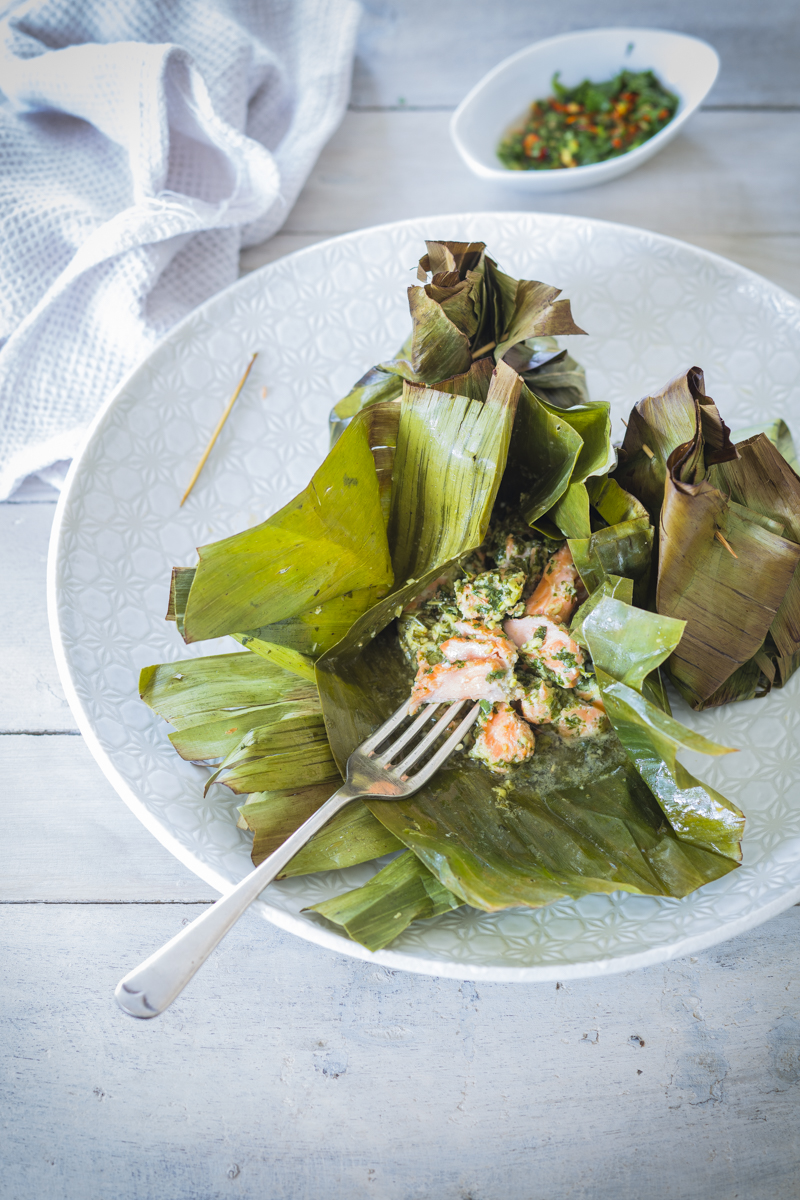 Salmon steamed in banana leaf