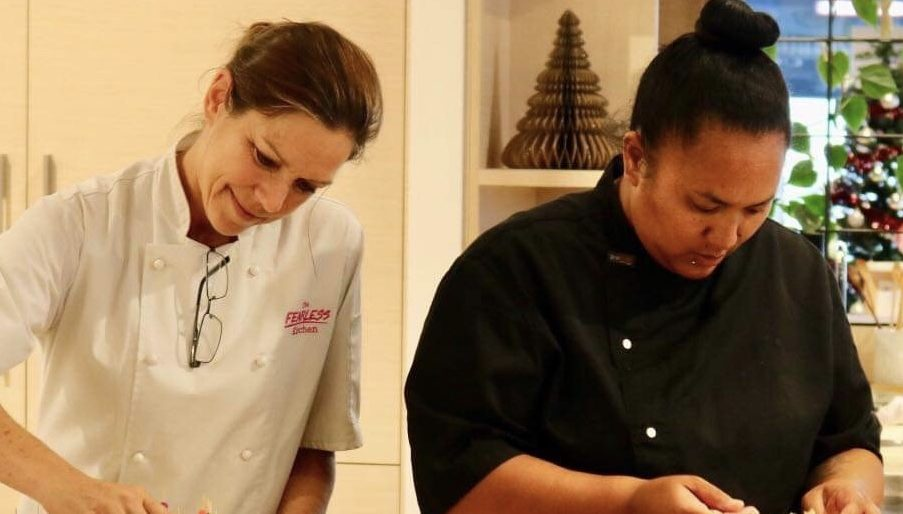 Vanessa working in the kitchen with Rose